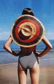 3. Think colorfully with this striped straw hat