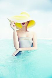 2. Woman in a yellow straw hat in the sea